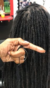 Nobody can repair dreadlocks like Braids By Bee her methods are self made and unique.