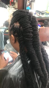 Braids by Bee creates dreadlocks while you sit in her salon chair customized on each client her Locs are called InstantLoc Dread Extensions.