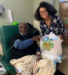 Rahmeka with patient at DAVita Dialysis Center in New York.