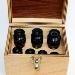 The case is large enough for today's larger wide field eyepieces, and a collection of smaller eyepieces.