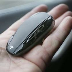 © AP Images … EVEN THE SMALLEST DETAILS LIKE TESLA'S KEY, WHICH IS AN RFID TRANSMITTER SHAPED AS THE CAR, ARE THOUGHTFUL.