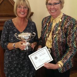 Winner of the Best In Show trophy at the 2013 BSG Exhibition, Trea Holmes of the Edinburgh Branch receives her award from the British Sugarcraft President, Pat Ashby.