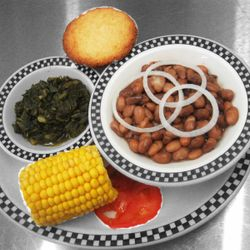 Buttermilk Cornbread, greens, pintos, and corn, just a sample of some of the delicious homemade sides Buttermilk has to offer!