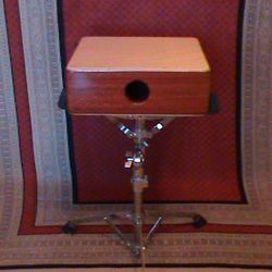 Bubinga Compact Snare Cajon in a Snare drum stand