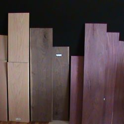 A selection of raw wood. Cherry. Honey Locust. Walnut. Purpleheart.