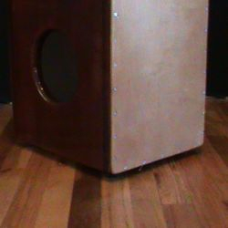 Kids String Cajon made of solid purpleheart with padouk binding. $529