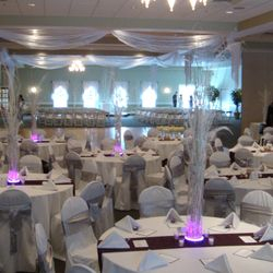 Dance floor draping creates a focal point and breaks up the ceiling