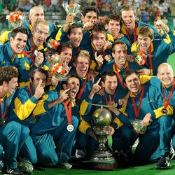 Australia hockey team celebrate with their trophy after winning the final of 2010.