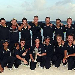 The victorious England team pose with World T20 2010 Trophy.