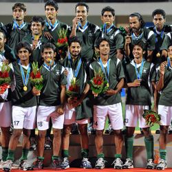 Asian Games 2010: The Pakistan hockey team celebrate their eighth Asian Games title.