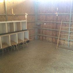 Inside barn where chickens lay their eggs.