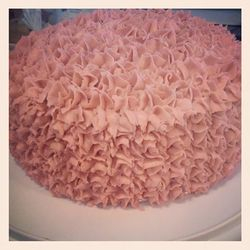 White chocolate cake, raspberry frosting, white chocolate frosting tinted a dusty rose.