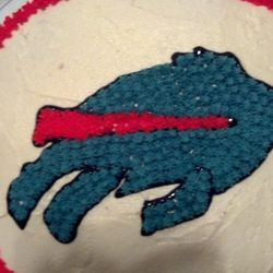 Buffalo Bills! White chocolate cake, raspberry filling, white chocolate buttercream frosting.