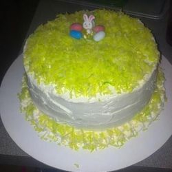 This is actually Summer Lovin' cake- vanilla bean cake with pineapple filling and coconut buttercream frosting- dressed up a bit with Easter decorations.