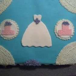 Bridal shower cake. White chocolate cake with strawberry buttercream filling with fondant.
