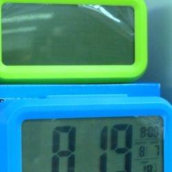 digital clock in both shops