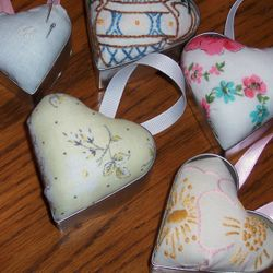 Pincushions made from cookie cutters and vintage linens