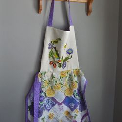 Really cute apron featuring some vintage crewel work as the bib.