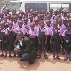Kivumbi with pupils in Namasuba Entebbe Rd