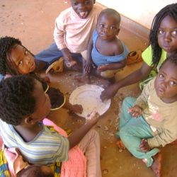 Childreen taking their lunch in our Centre