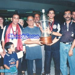 Noor Sabri holds the 2002 WAFF Championship trophy