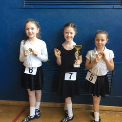First Feis showing off their medals and trophies