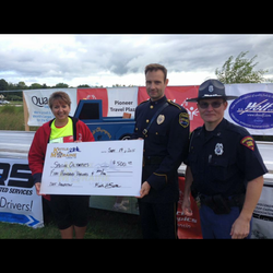 Donating to Special Olympics Truck Convoy.