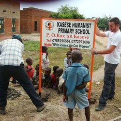 Erecting the KHPS signpost along a Kasese suburb road