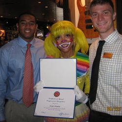 Lady Rainbow is presented with certificate of Special Recognition by the office of John Lewis/member of congress.