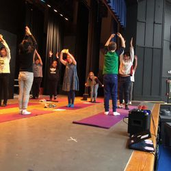 Students perform a yoga set during our Winter Celebration