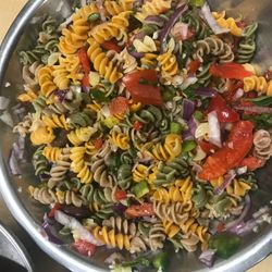 Pasta salad made by students in Health and Nutrition. Ingredients: Organic pasta, plum tomatoes, red onion, green pepper, red pepper, basil, oregano, Italian seasoning, olive oil, sea salt, cayenne pepper, olives, garlic, lemon juice, Parmesan cheese