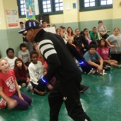 Performer Roger G captivates the students during a performance