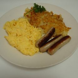 Two eggs scrambled with sausage links and our homemade American fries