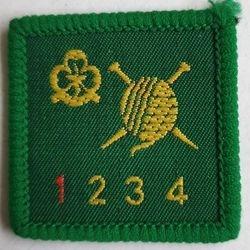Knitter level 1 (older trefoil)