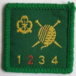 Knitter level 2 (older trefoil)