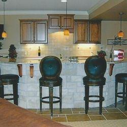 Finished basement with a custom bar area