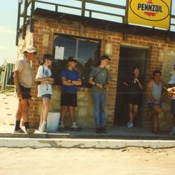 Tony Frisina in blue shorts, founding member. Wyllie giving the trophy out, wife Sharon in the doorway