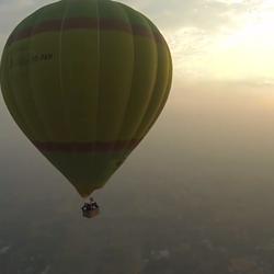 Hot air balloon over a field near Jaipur, India