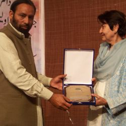presenting Sheild to Justice Dr. Nasira Javed Iqbal..9th Feb 2013