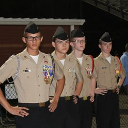 "Cadets Ramos, Steinhauer, Harrison, & Combs ""Puffy"" pose for a photo during a Harrison High School football game."