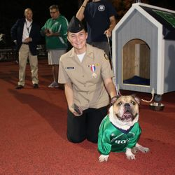 """Who Let the Dawgs Out?"" Cadet Simmons spends a little time with the Harrison mascot during a home football game."