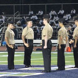 Harrison Cadets provide a sword detail in support of the school's last home football game for the season.
