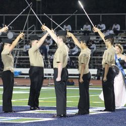 Harrison Cadets provide a sword detail in support of the schools last regular home football game for the season.