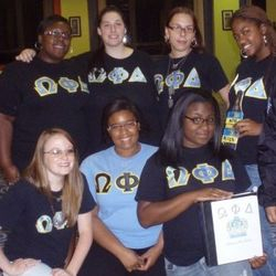 sisters posing for a photo at a recruitment event.