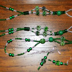 Barefoot sandals in greens with matching hand jewelry.  Also available in pink, purple, orange, red, blue, white, black.