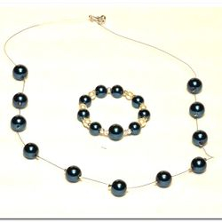 Floating necklace with matching bracelet. Gorgeous blue colored glass pearls.