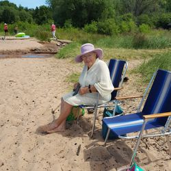 Shirley enjoys a little beach time at her family cabin on Lake Superior.