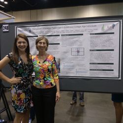Rachel and Dr. King standing by their poster presentation at the National American College of Sports Medicine 2014 Conference