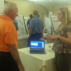 Samantha explaining MatScan software to an NH-INBRE Conference attendee