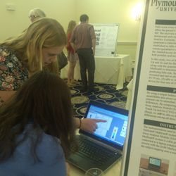 Samantha explaining to an NH-INBRE Conference attendee the data from MatScan